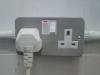 Damaged double socket outlet